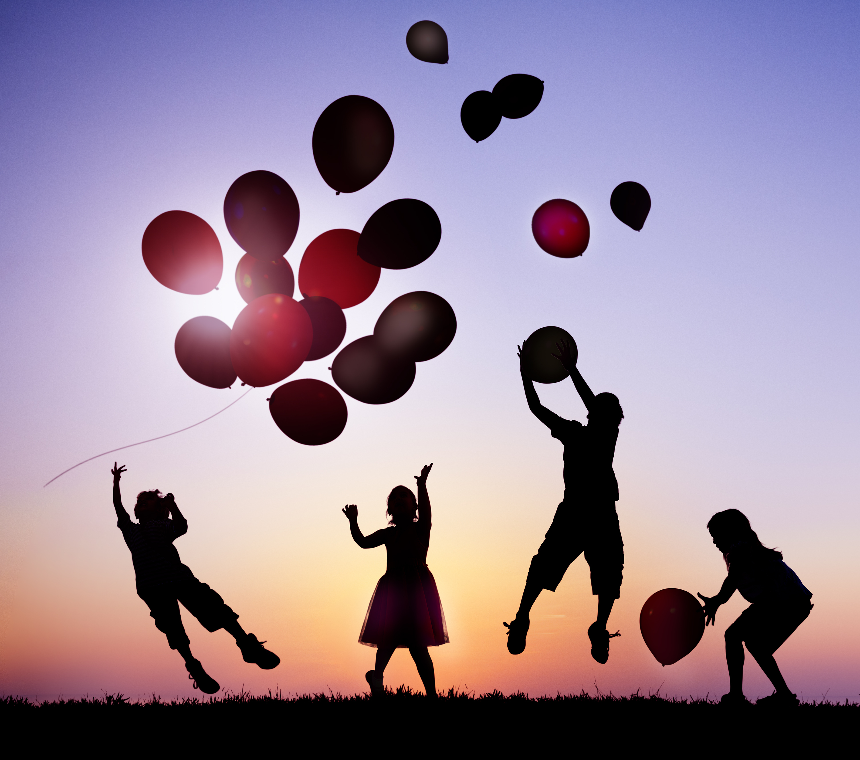 Children Outdoors Playing with Balloons